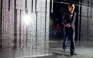 Carlo Ratti demonstrating the opening of the curtain of water due to sensors